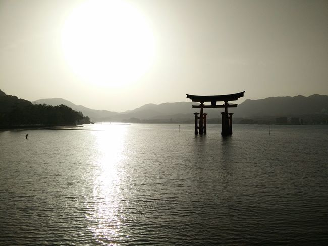 Torii Gate Built Structure Travel Destinations Culture Famous Place Tourism Water Scenics Spirituality Travel Tranquil Scene Religion Waterfront Reflection Sun Tranquility Architecture Mountain International Landmark UNESCO World Heritage Site