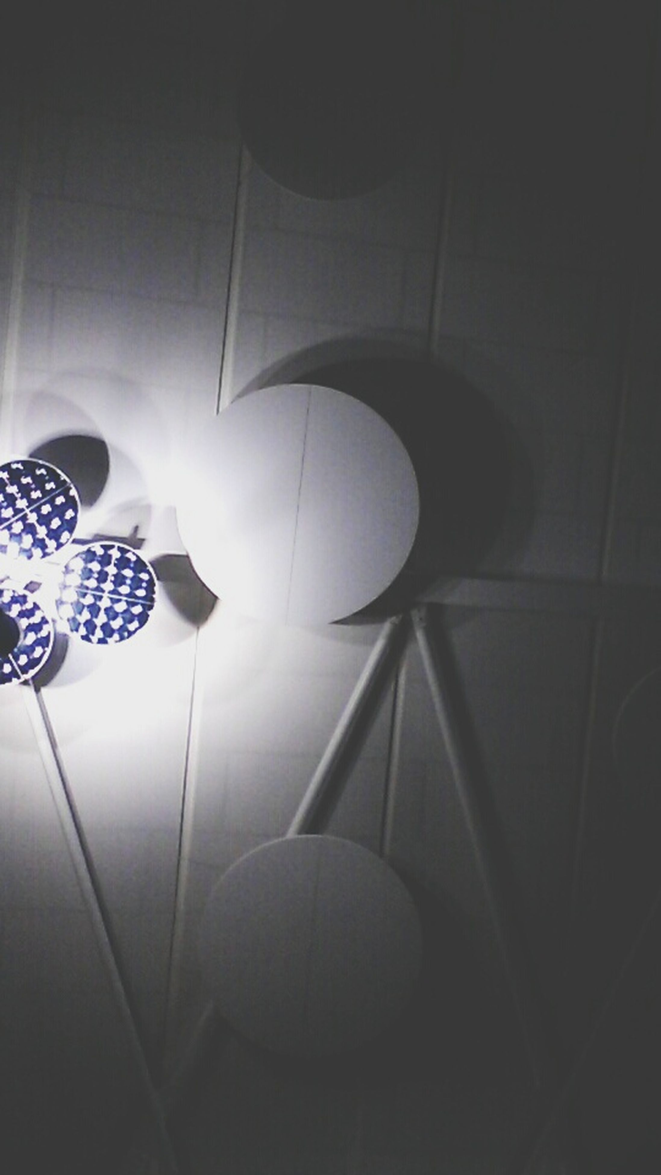 indoors, illuminated, lighting equipment, ceiling, wall - building feature, electricity, light - natural phenomenon, home interior, electric lamp, low angle view, hanging, electric light, no people, decoration, pattern, built structure, design, lamp, architecture, glowing