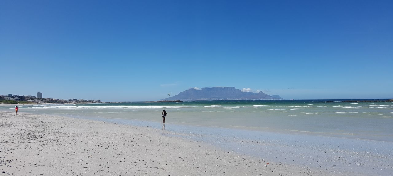 Adult Beach Beauty In Nature Blouberg Strand Blue Clear Sky Day Full Length Horizon Over Water Nature Outdoors People Sand Scenics Sea Sky South Africa 🇿🇦 Summer Table Mountain Tranquil Scene Tranquility Vacations Water Wave
