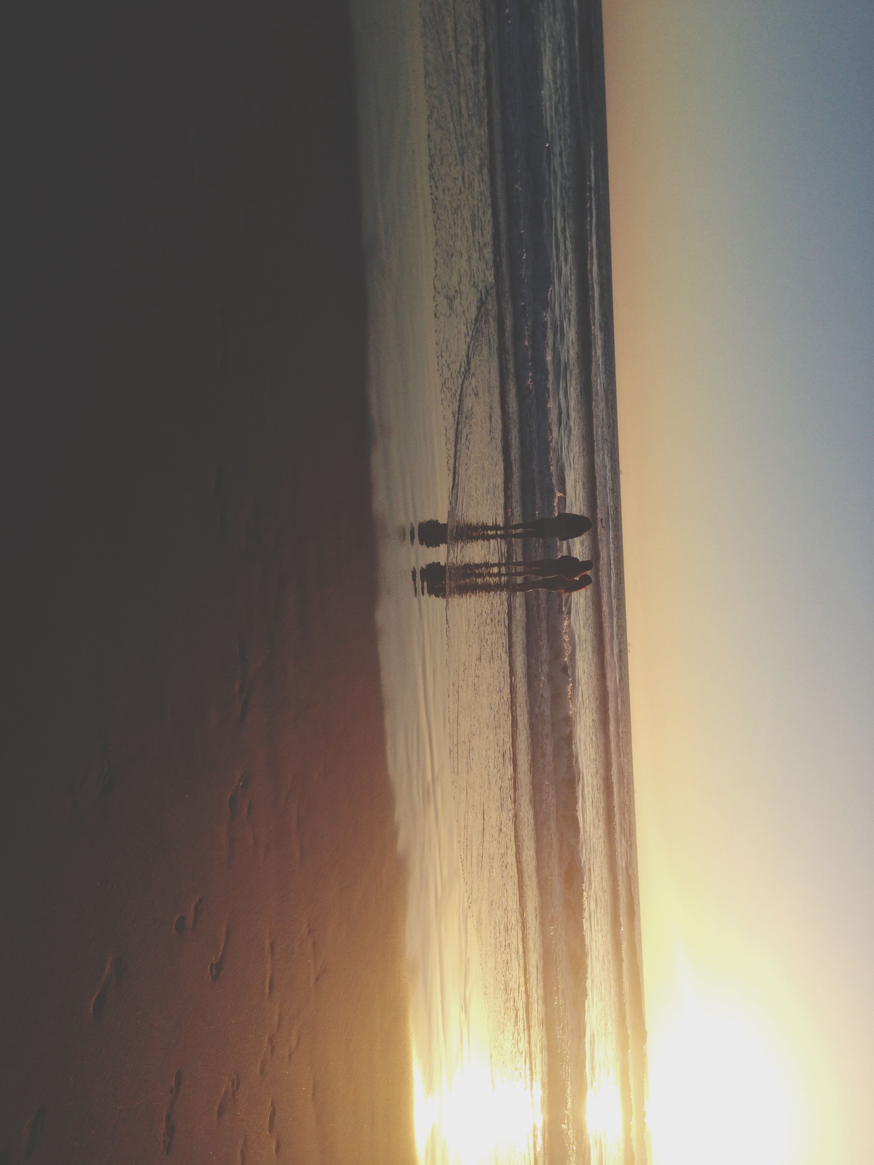 sea, horizon over water, water, beach, sunset, scenics, tranquil scene, shore, tranquility, beauty in nature, sun, silhouette, nature, clear sky, idyllic, sky, copy space, sunlight, sand