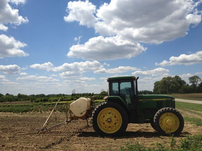 Agricultural Machinery Agriculture Cloud Cloud - Sky Cultivated Land Day Dirt Road Farm Field Harvesting Land Vehicle Landscape Mode Of Transport Nature Parked Plantation Plough Plowed Field Rural Scene Sky Stationary Surface Level Tractor Tranquil Scene Transportation
