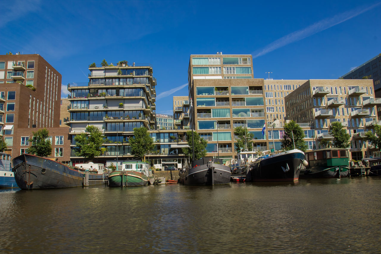architecture, built structure, building exterior, transportation, waterfront, nautical vessel, outdoors, water, day, no people, blue, city, clear sky, sky