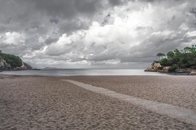 Cala Sa Tuna in Begur Beach Beauty In Nature Calm Cat Catalonia Cloud Cloud - Sky Cloudy Coastline Costa Brava Girl Horizon Over Water Idyllic Nature Overcast Remote Sa Tuna Scenics Sea Shore Sky Tranquil Scene Tranquility Water Weather