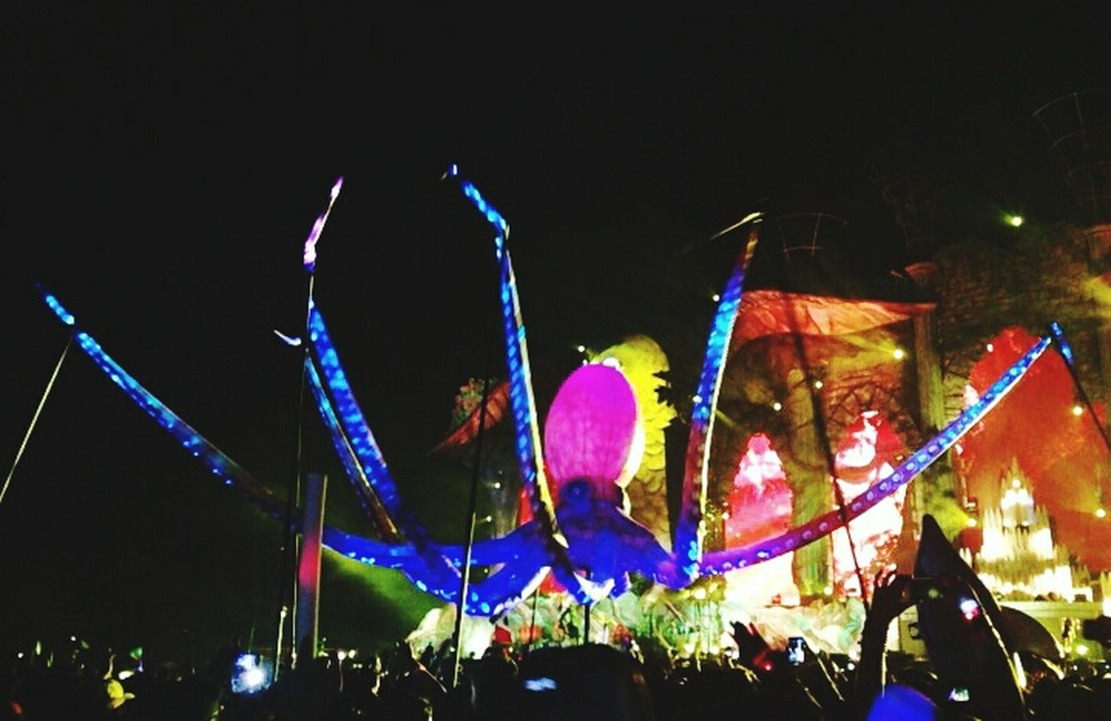 illuminated, night, multi colored, arts culture and entertainment, celebration, amusement park, low angle view, clear sky, amusement park ride, lighting equipment, decoration, sky, built structure, light - natural phenomenon, outdoors, copy space, building exterior, architecture, glowing, city