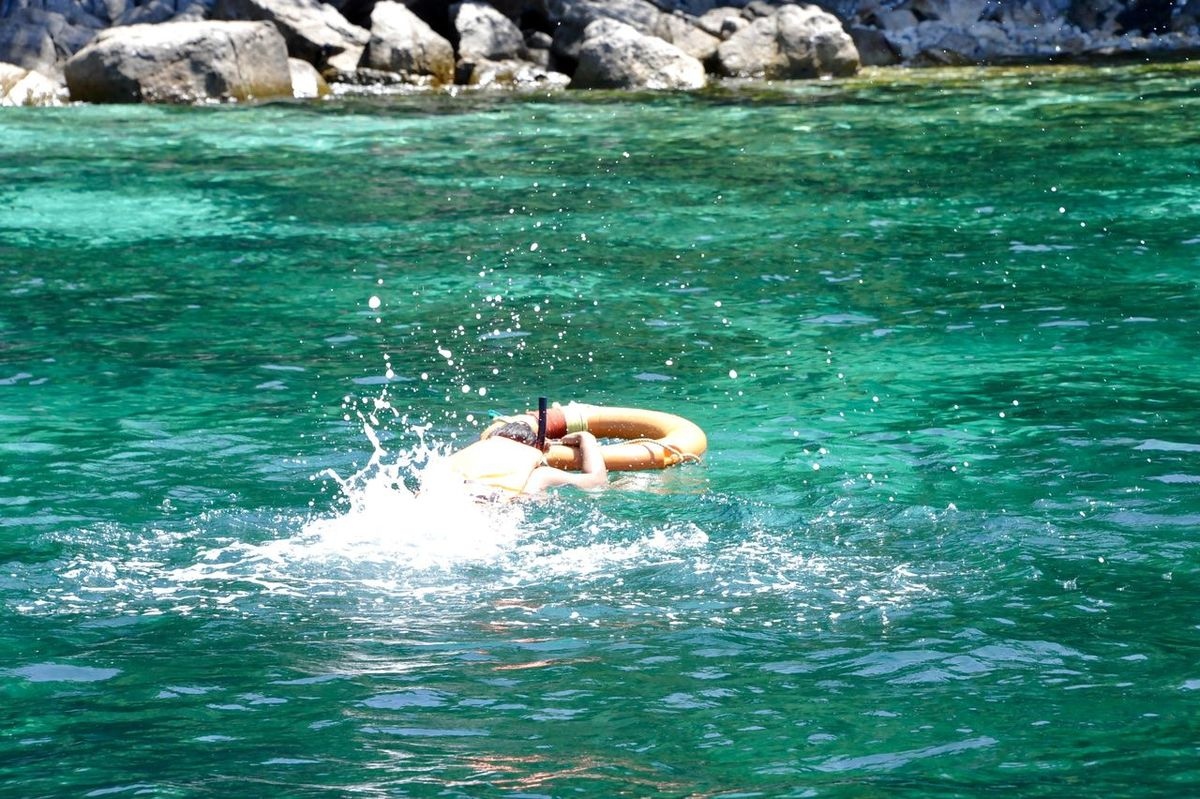 Beauty In Nature Day Koh Lipe Koh Lipe Thailand Leisure Activity Lifestyles Nature One Person Outdoors Real People Sea Swimming Thailand Vacations Water Waterfront