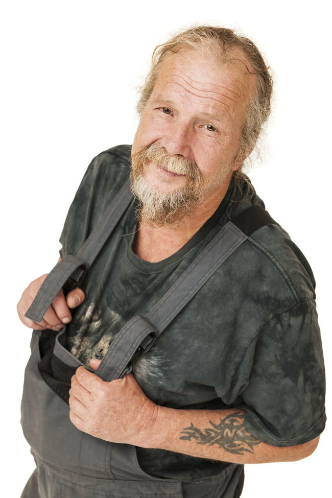 Upper body portrait of an older man with a beard in dark gray work clothes, her arms crossed against white background satisfied smiling into the camera Casual Clothing Dungarees Elderly Front View Jacket Leisure Activity Lifestyles Person Portrait Of A Man  Satisfied  Senior Portrait Studio Shot Waist Up White Background Worker Young Adult Young Men