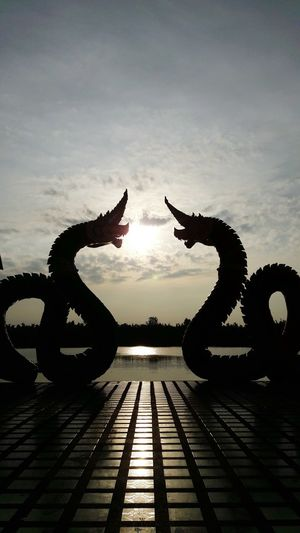 Silhouette No People Sculpture Outdoors Water Day Animal Themes Nature Sky river culture naka dark Lovephotography  Sky And Clouds Riverside Sight Water Reflections Ñaka Legend Couple In Love Light And Shadow Backgrounds Believing Motion Water