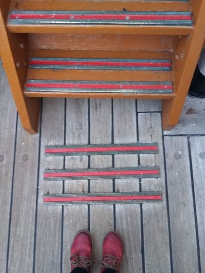Colors And Patterns Low Section Shoe Personal Perspective Person Wood - Material Human Foot High Angle View Red Part Of Footwear Wooden Day Pink Color EyeEm Best Shots EyeEm Gallery The Purist (no Edit, No Filter) Floortraits Foot Wear  Red Boots Floortrait Looking Down Wooden Texture Wooden Floor Stairs