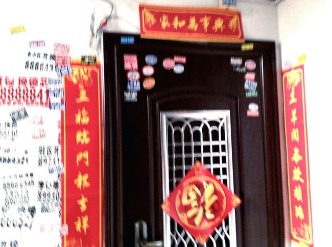 Advertisements and door decorations Advertisement Advertising Ads Wall On The Wall Door Door Decoration Chinese Culture Chinese Characters Gatepost Couplet Upside-down 'fu' Character Tradition Traditional Interior Style Colour Of Life Travel Qingdao China Decoration Culture