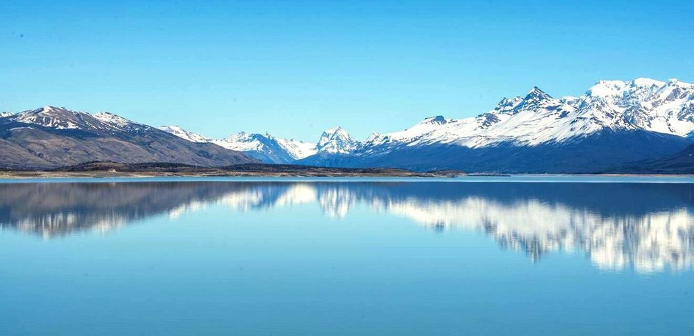 Mountain Mountain Range Reflection Scenics Lake Beauty In Nature Snowcapped Mountain Snow Nature Tranquil Scene Tranquility Blue Idyllic No People Day Water Winter Outdoors Mountain Peak Clear Sky Calafate elcalafate