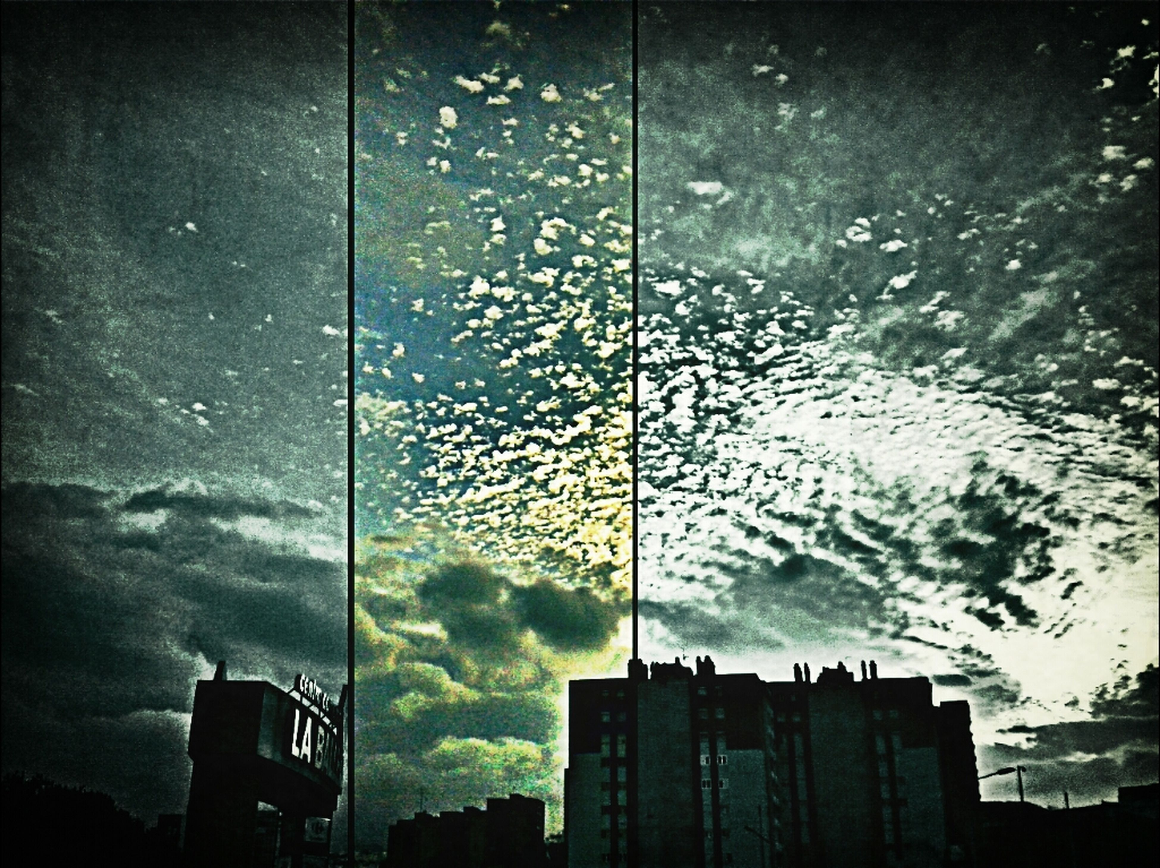 building exterior, architecture, low angle view, built structure, silhouette, sky, building, city, cloud - sky, street light, dusk, outdoors, weather, no people, cloudy, window, residential building, cloud, tall - high, tower