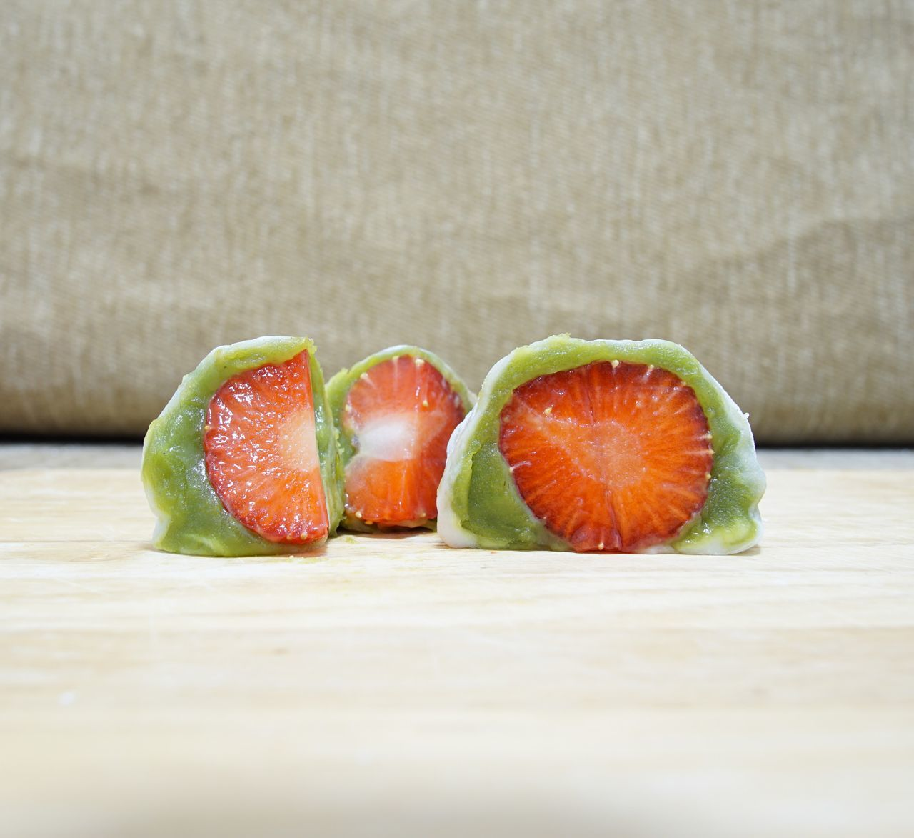Mochi green tea with fresh strawberry. Its taste is really good, sweet and sour the one bite. Close-up Day Dessert Food Food And Drink Freshness Fruit Green Color Greentea Healthy Eating Indoors  Japnesedessert Mochi No People Ready-to-eat Red Ricecake SLICE Strawberry Sweet Table