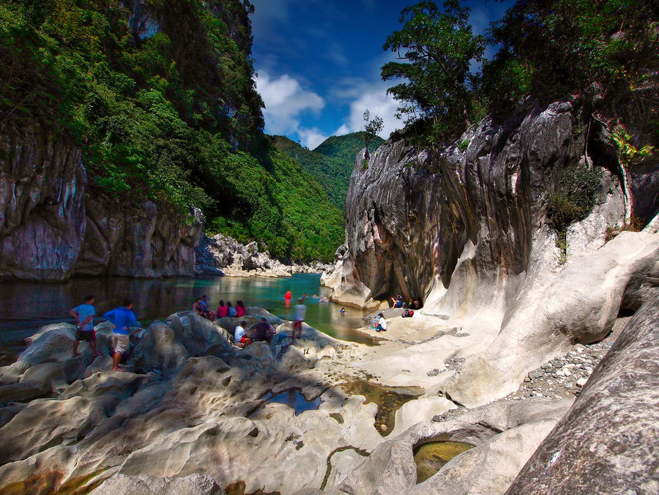 Tinipak River Beauty In Nature Bouquet Geology Idyllic Leisure Activity Lifestyles Non-urban Scene Outdoors River Rock Rock - Object Rock Formation Scenics Sky TinipakRiver Tourism Tourist Tranquil Scene Tranquility Water
