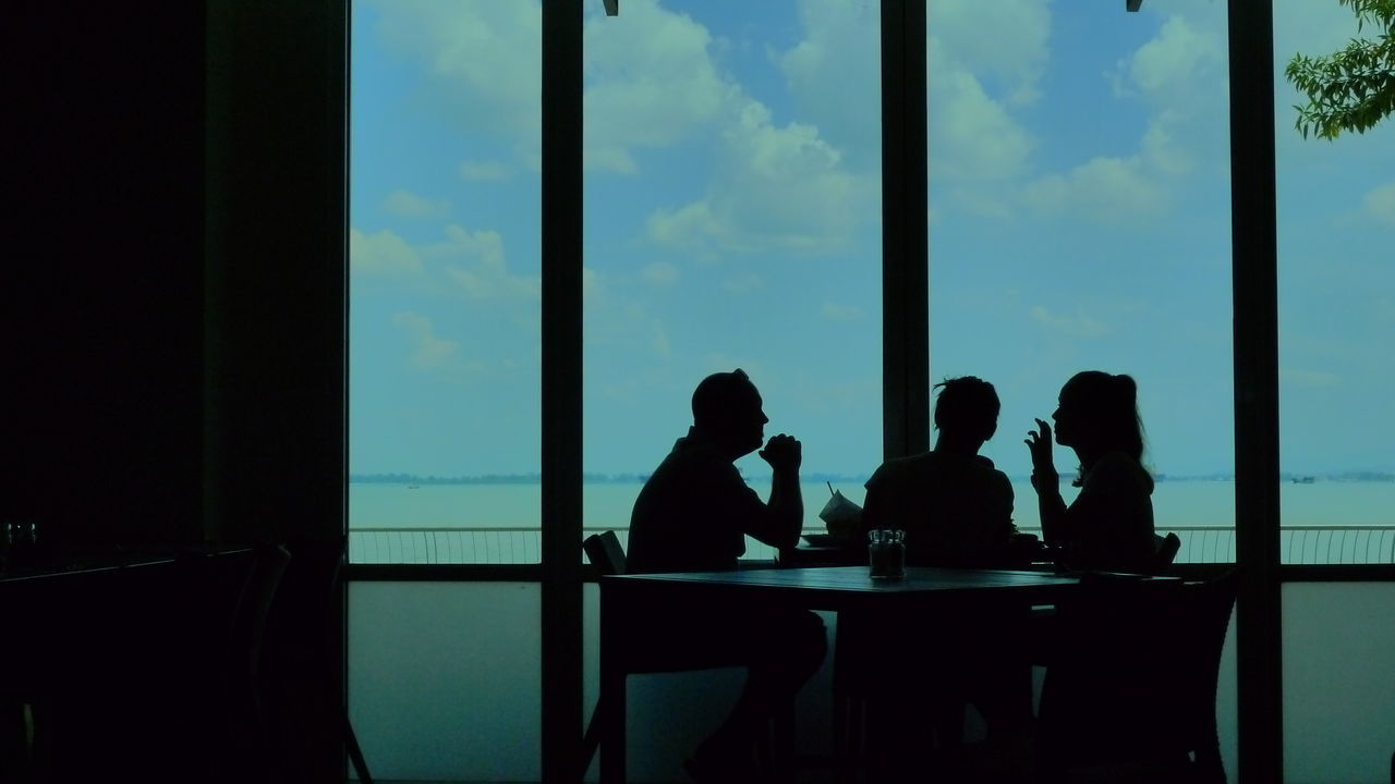 table, indoors, window, silhouette, men, togetherness, sky, real people, business, day, food and drink, sitting, businessman, cooperation, women, teamwork, friendship, people