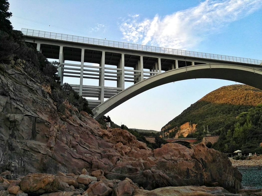 Bridge - Man Made Structure Connection Arch Built Structure Travel Destinations Architecture Landscape Outdoors Day Sky No People Nature Sea Sea And Sky Rock Formation Rocks And Water Rocks Rock Beauty In Nature Plants Nature Photography Human Made Bridge Bridge Over Water Livorno