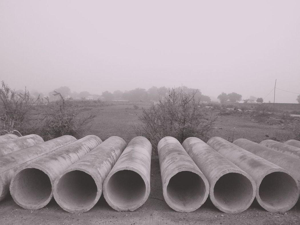 EyeEm Selects Stack Pipe - Tube Industry In A Row Repetition Water Pipe Factory Tree