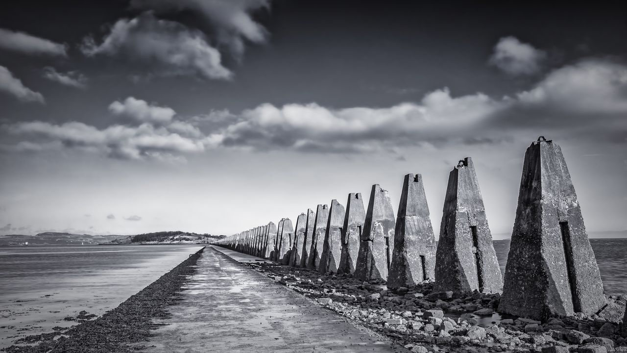 Cramond Island walkway Edinburgh Cramond Cramondisland Scotland Island Shore Sea Seaside Sky Cloudysky Clouds No People Tranquil Scene The Way Forward Sand Beach Outdoors Blackandwhite Stones Stones & Water Landscape Scenics FirthOfForth Pylons Antisubmarine