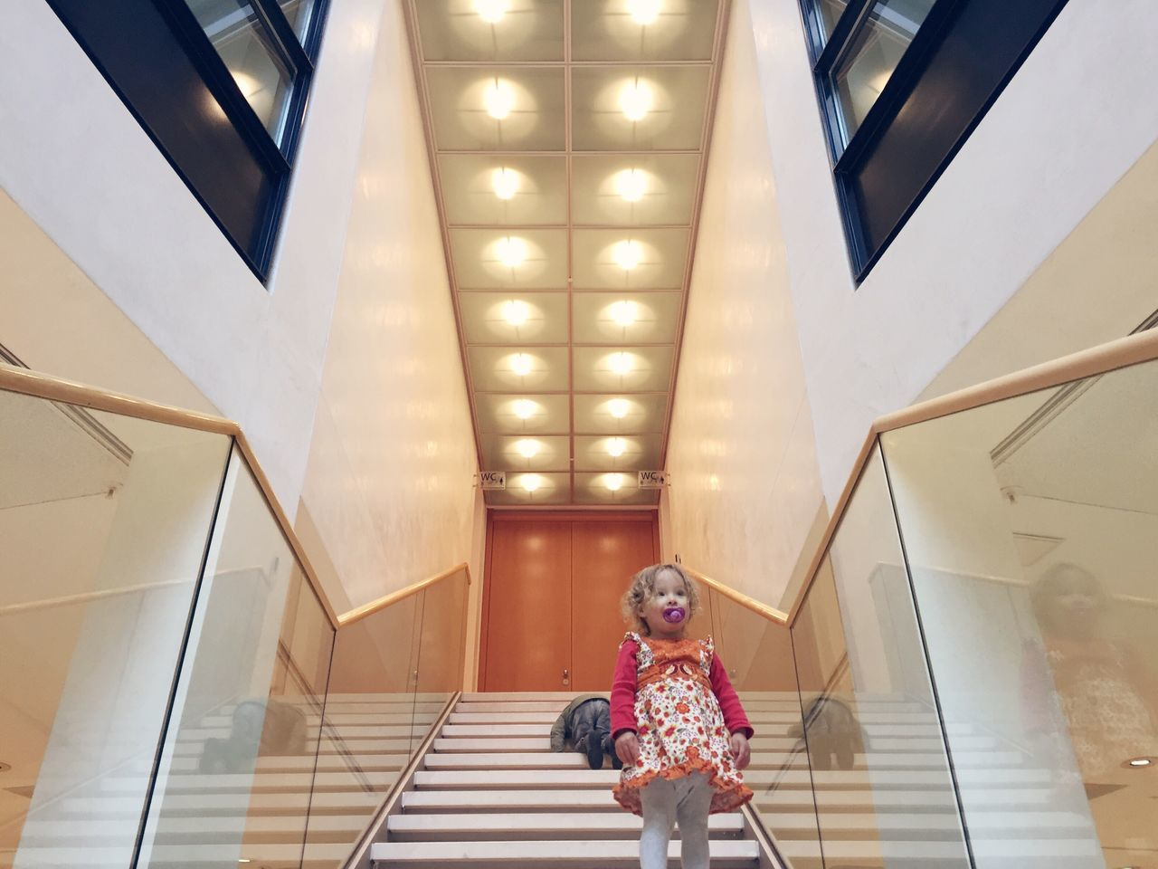 Real People Steps Staircase One Person Indoors  Lifestyles Steps And Staircases Leisure Activity Low Angle View Architecture Girl Standing Childhood Hand Rail Day People
