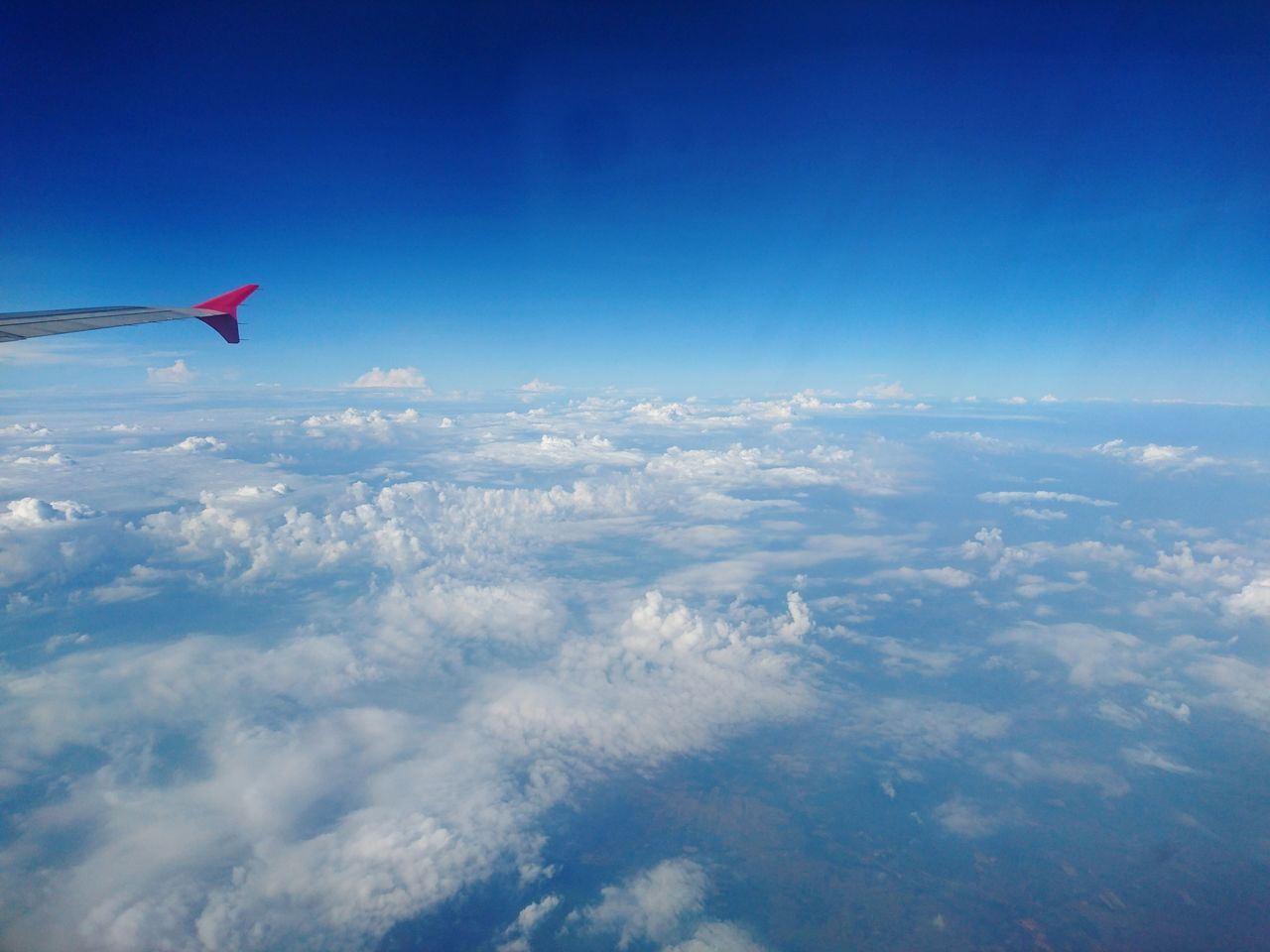 blue, sky, nature, beauty in nature, scenics, cloud - sky, no people, travel, outdoors, aerial view, flying, transportation, airplane, day, airplane wing