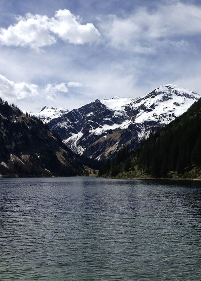 scenic view of lake in the alps, tannheimer tal, tirol Alps Amazing Beauty In Nature Clouds Holiday Lake Landscape Life Light Mountain Nature Outdoors Scenery Scenics Sky Snow Snowcapped Mountain Spring Tannheimer Tal The Great Outdoors - 2017 EyeEm Awards Tranquil Scene Travel Vilsalpsee Water Wilderness Been There. Been There. Connected By Travel