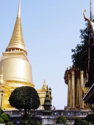 Grand Palace Bangkok Thailand Wat Prakeaw Bangkok Religion Building Exterior Gold Colored Spirituality Built Structure Architecture Place Of Worship Outdoors Gold Tree Clear Sky Travel Destinations Low Angle View No People Day Sky EyeEm Nature Lover EyeEm Best Shots EyeEm Thailand