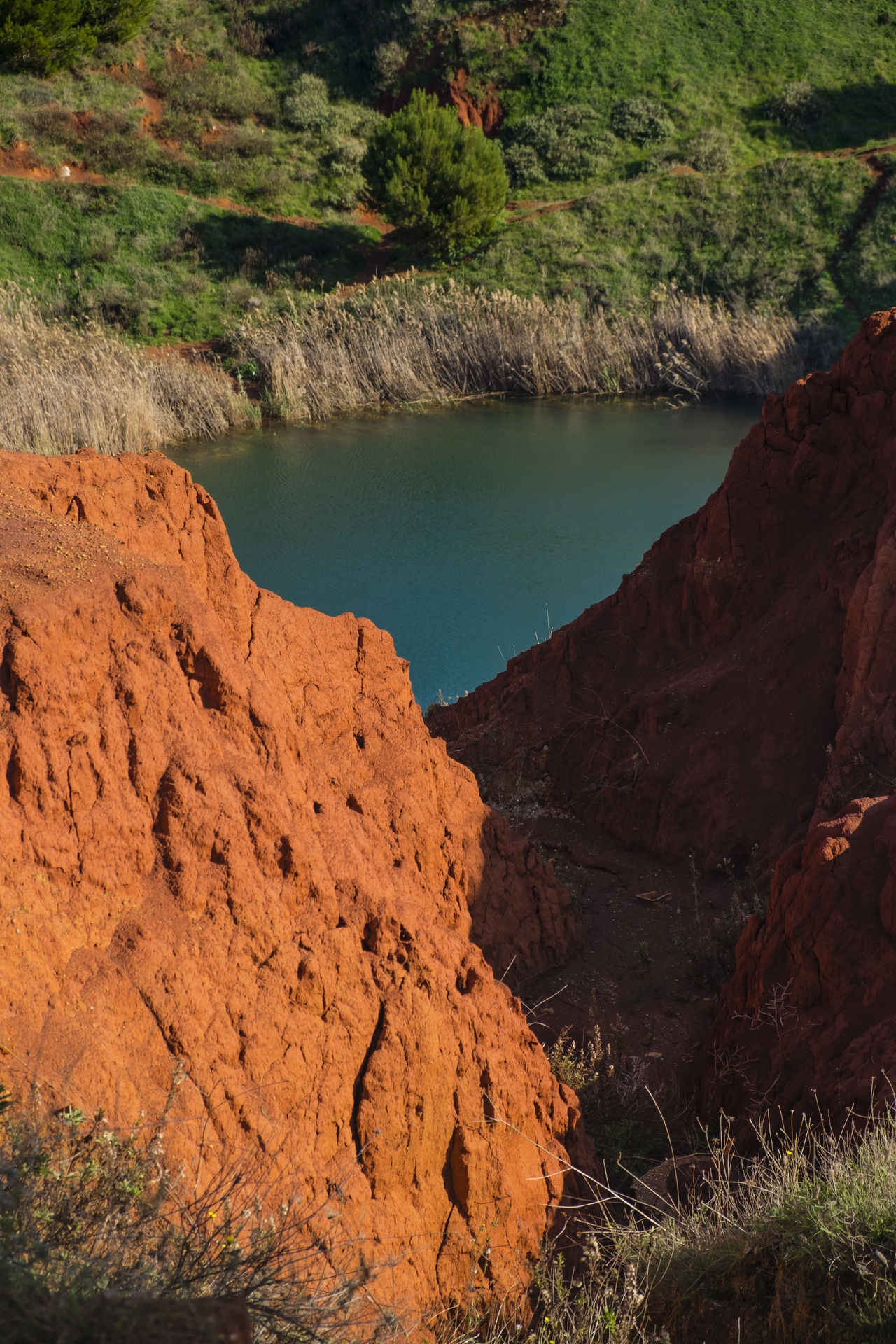 Bauxite Bauxite Cave Beauty In Nature Cave Day Environmental Conservation Lake Lake View Landscape Landscape_photography Mountain Nature No People Outdoors Rock - Object Scenics Tranquility Travel Destinations Vacations Water