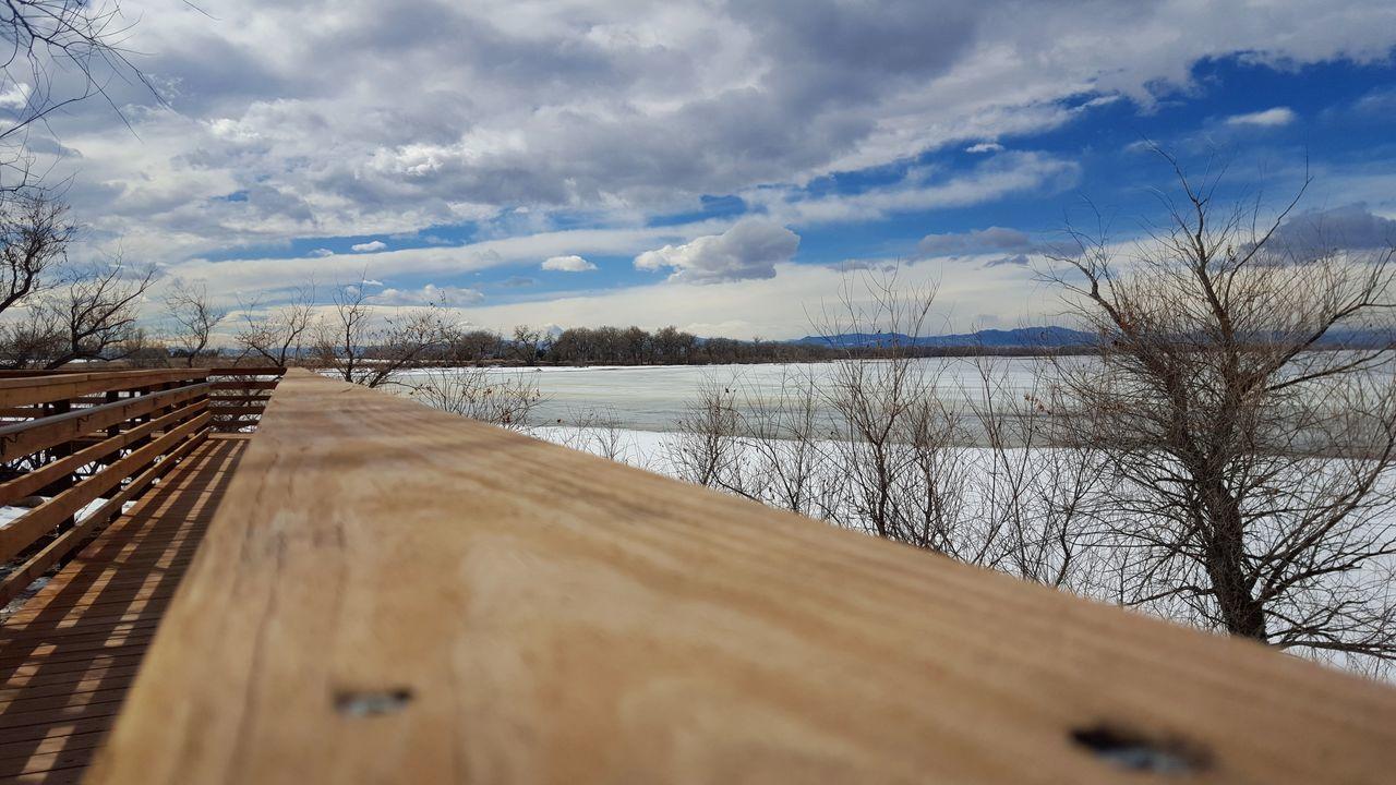 Walking the boardwalk at Barr Lake Stste Park. Taking Photos Winter Colorado Frozenlake Barr Lake State Park