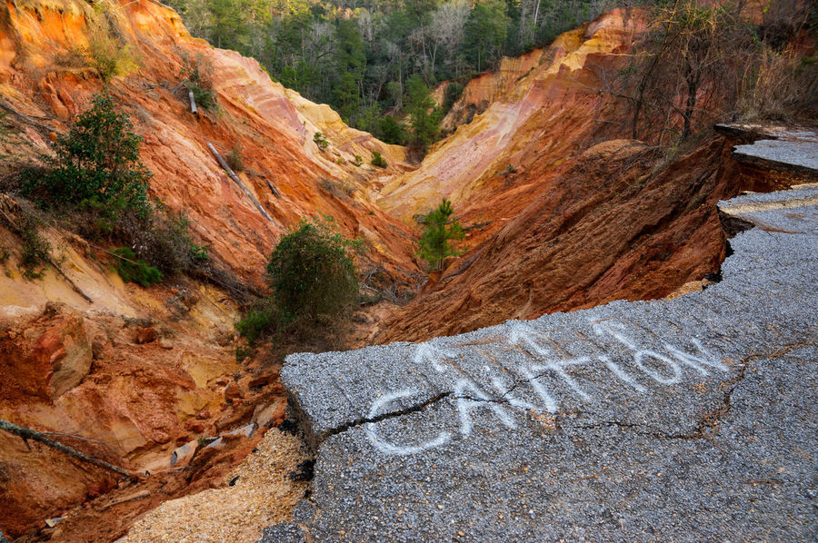 Caution Autumn Beauty In Nature Cliff Day Dropoff Landscape Nature No People Outdoors Pavement Ravine Road Closed Scenics