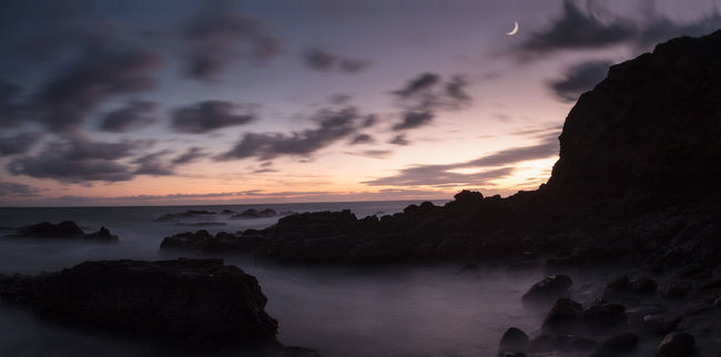 Moonset and sunset at Crescent Bay beach in Laguna Beach, California, United States Beauty In Nature California Laguna Beach Landscape Long Exposure Moonset Nature No People Outdoors Rock - Object Rocks Sky Sunset Sunsets