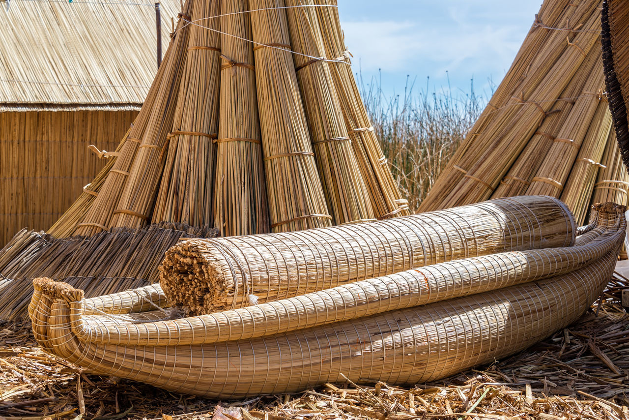 Reed boat on the manmade Uros floating islands on Lake Titicaca near Puno, Peru America Andes Boat Destination Floating Inca Lake Landscape Latin Native Nature Peru Peruvian Puno Puno, Perú Reed Scenic Sky Titicaca Titicaca Lake Totora Travel Uros Uros Island Water