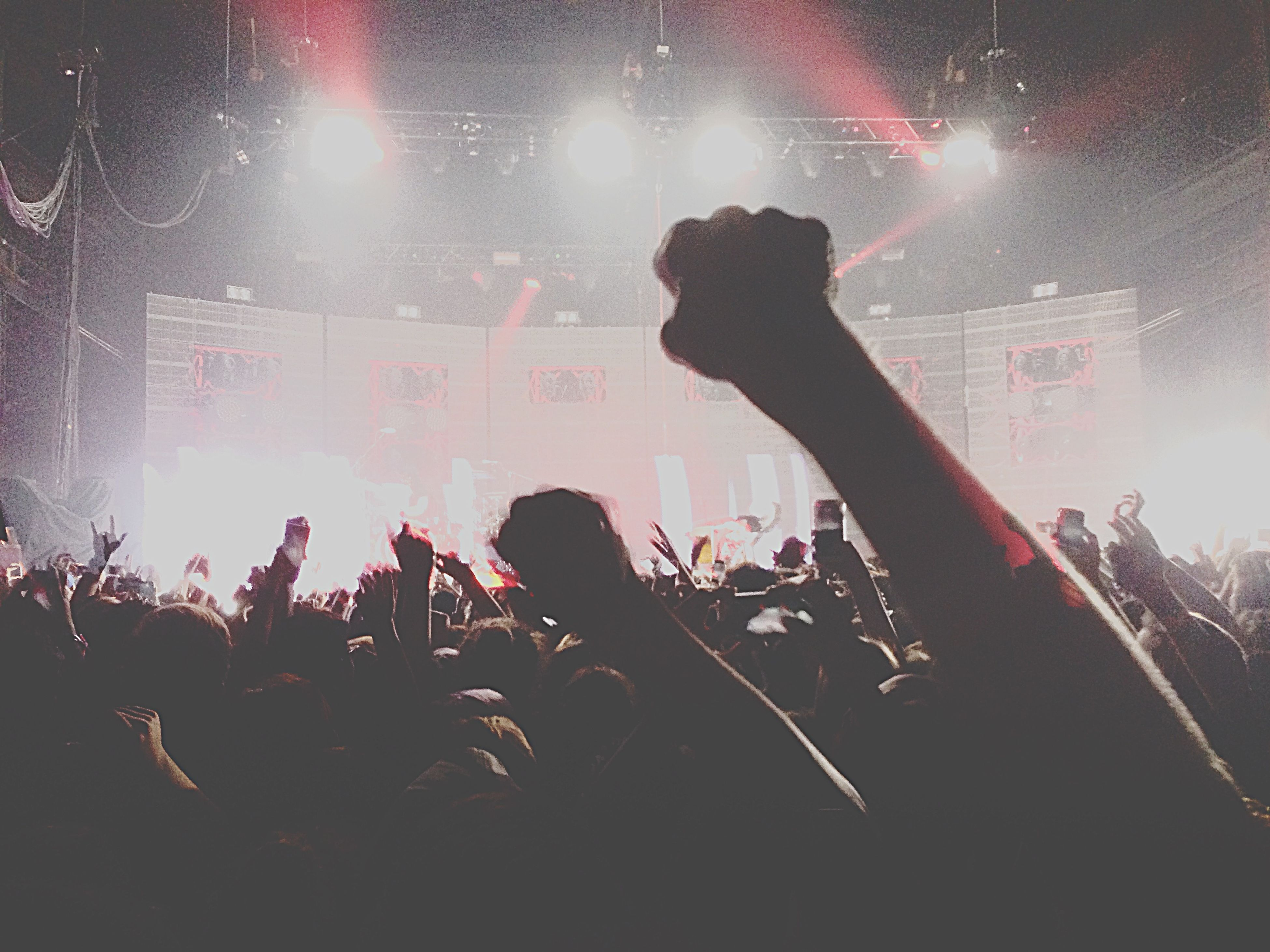 illuminated, lifestyles, arts culture and entertainment, night, leisure activity, large group of people, enjoyment, performance, music, nightlife, crowd, men, fun, event, youth culture, celebration, music festival, person, togetherness