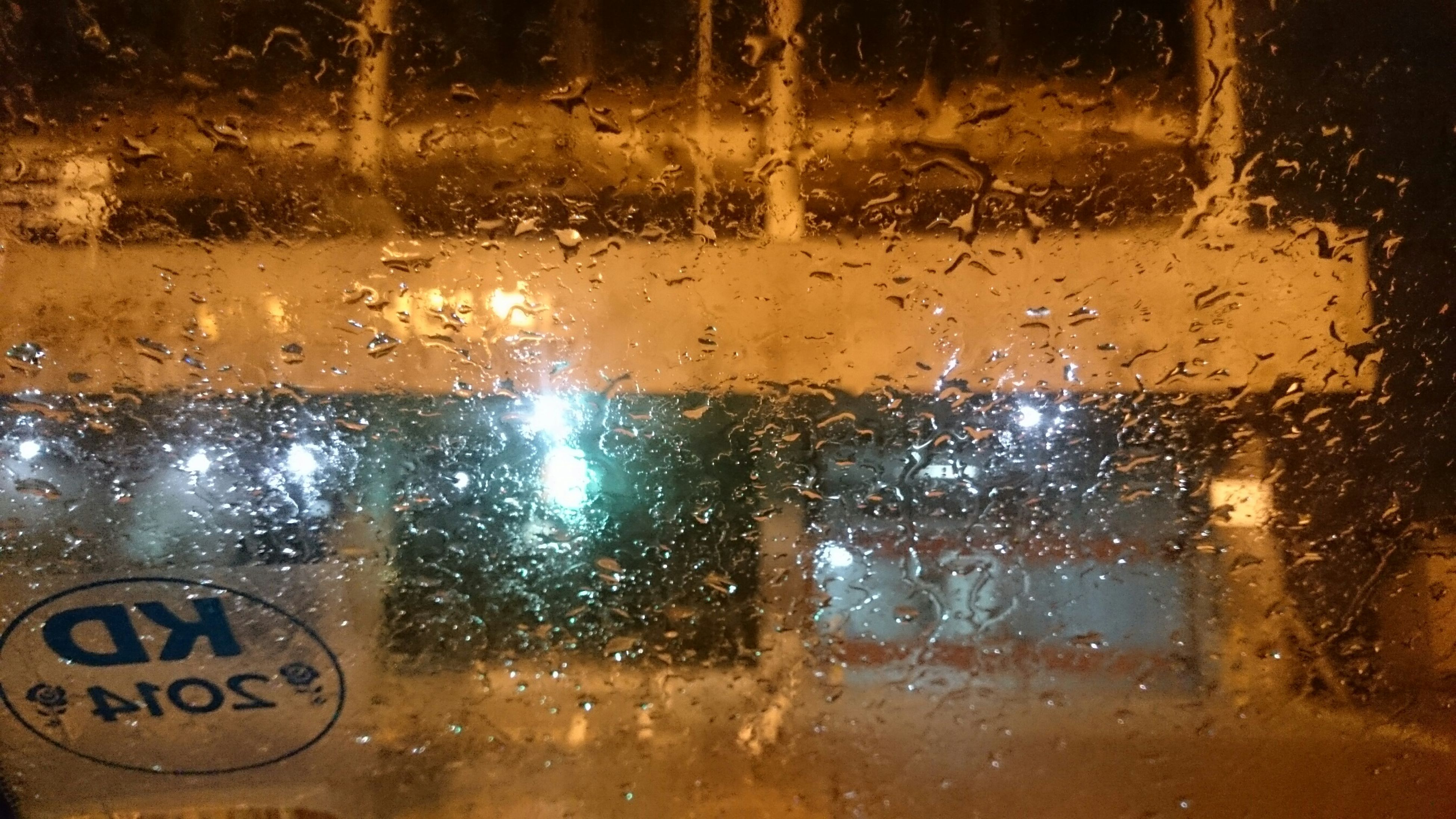 glass - material, drop, wet, window, full frame, transparent, water, indoors, backgrounds, rain, close-up, raindrop, season, weather, glass, text, communication, focus on foreground, condensation, no people