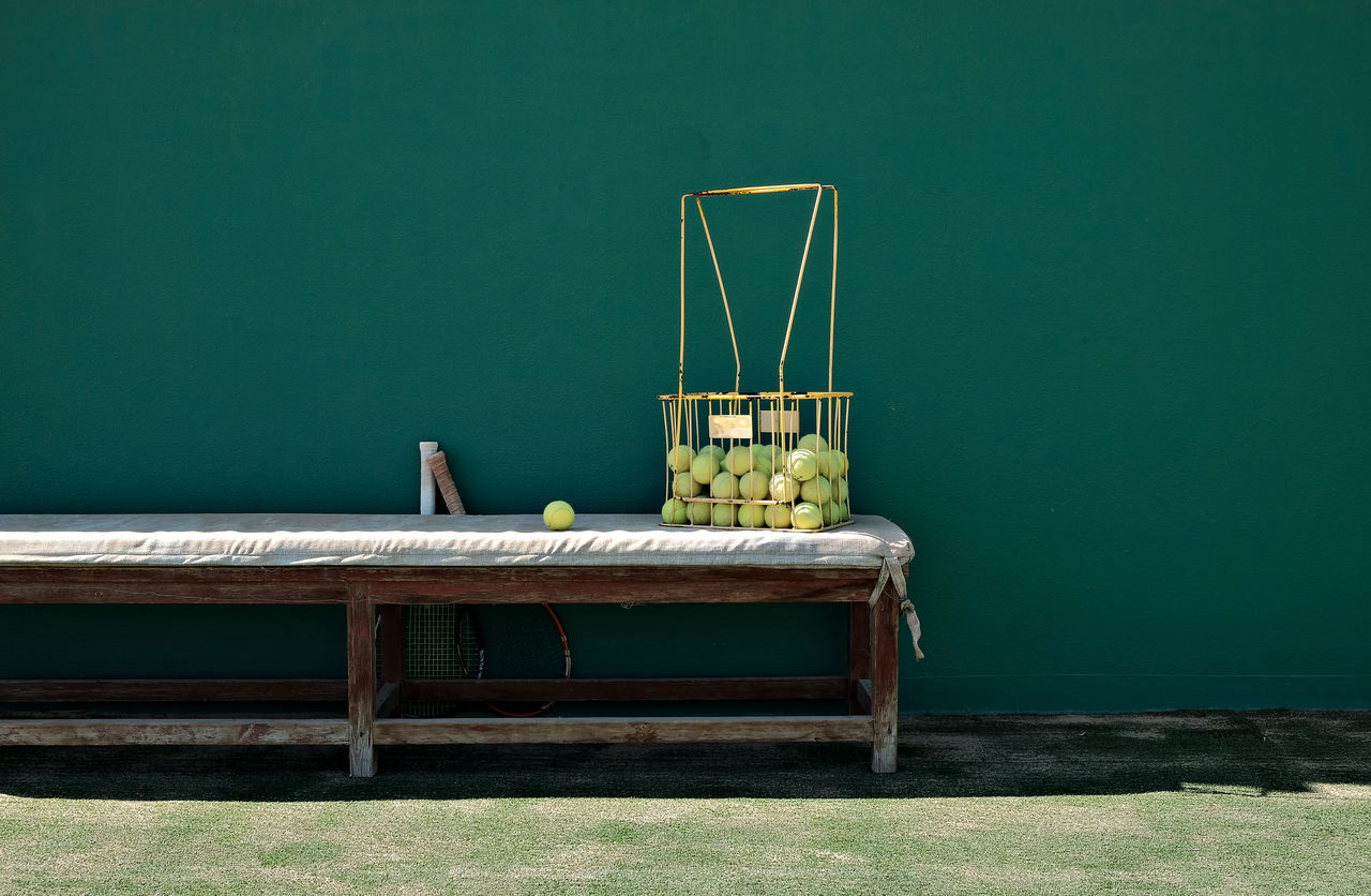 Abandoned Basket Full Of Tennis Balls Competition Day Green Wall High Contrast Leftbehind Light And Shadow No People Old Bench Sport Sunshine Tennis Balls Tennis Court Tennis Rackets Tennis Training Vintage