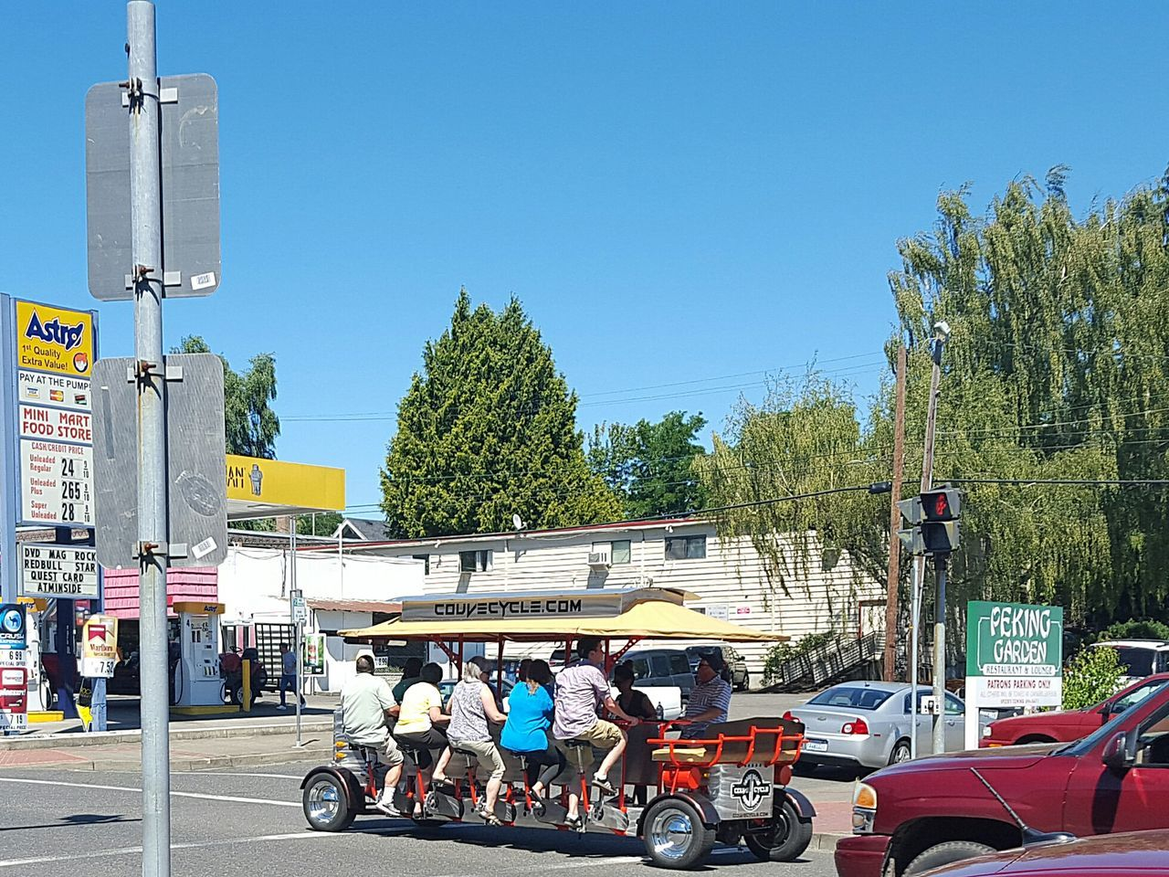 Couv Cycle down Main Street Mode Of Transport Land Vehicle Transportation City Street Pedal Power Pedalcar Pedal Pedalling Pedal Powered Unique Vehicles Summer Summertime Exercise Exploring The City Exploring The City Streets Pacific Northwest  PNW Washington State PNWonderland Vancouver, Washington Vancouver Washington Vancouverwashington Vancouver Live For The Story Let's Go. Together.