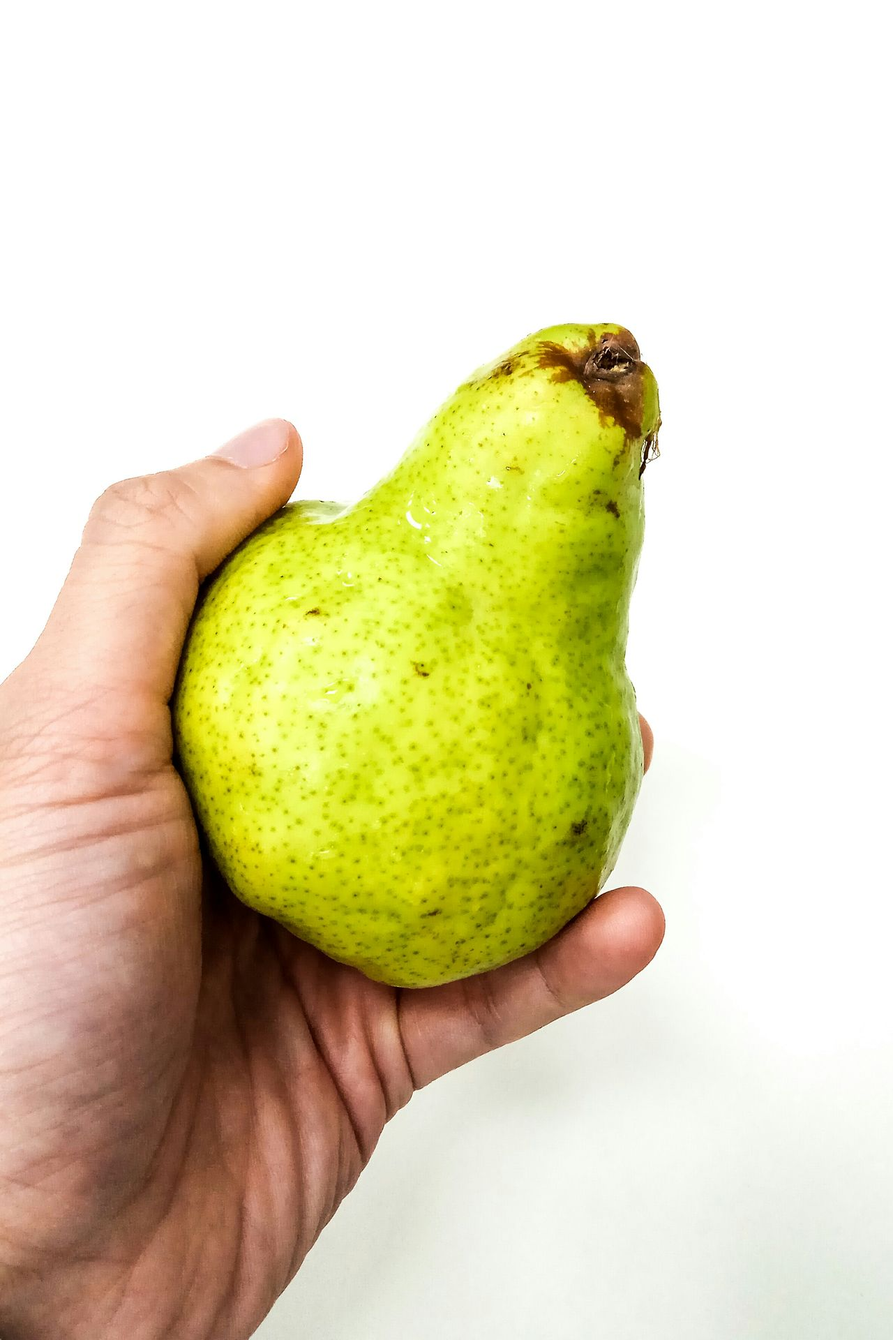 I Have A Pear Today Human Hand Human Body Part One Person Food And Drink Holding Food Fruit Freshness White Background Healthy Eating Leisure Activity Close-up People Adults Only One Man Only Day Adult Urban Lifestyle No People Wealthy Adults Only Wealthy Lifestyle Indoors