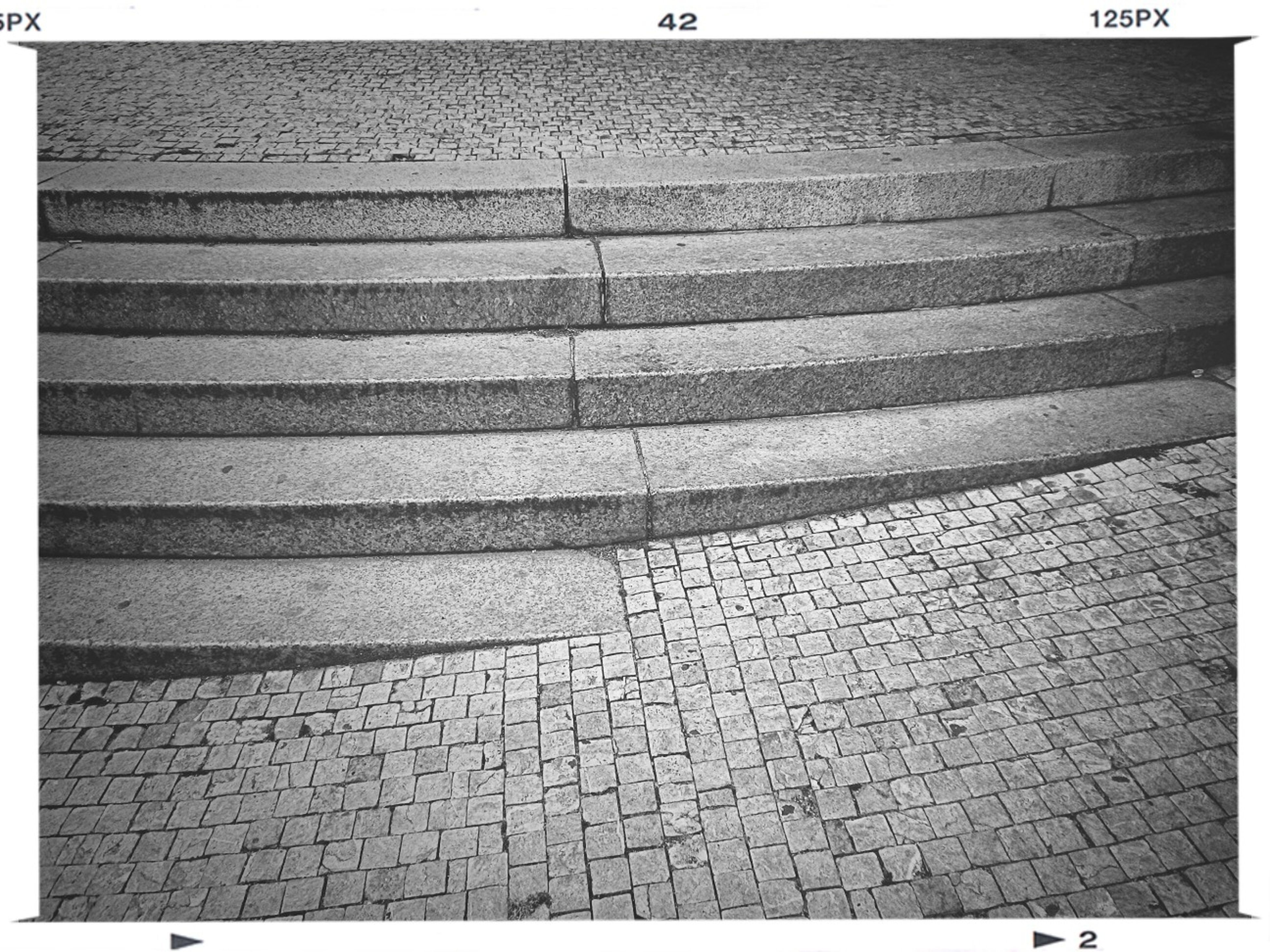 transfer print, auto post production filter, cobblestone, pattern, paving stone, textured, street, full frame, sidewalk, footpath, outdoors, day, backgrounds, high angle view, the way forward, no people, sunlight, pavement, road marking, wall - building feature