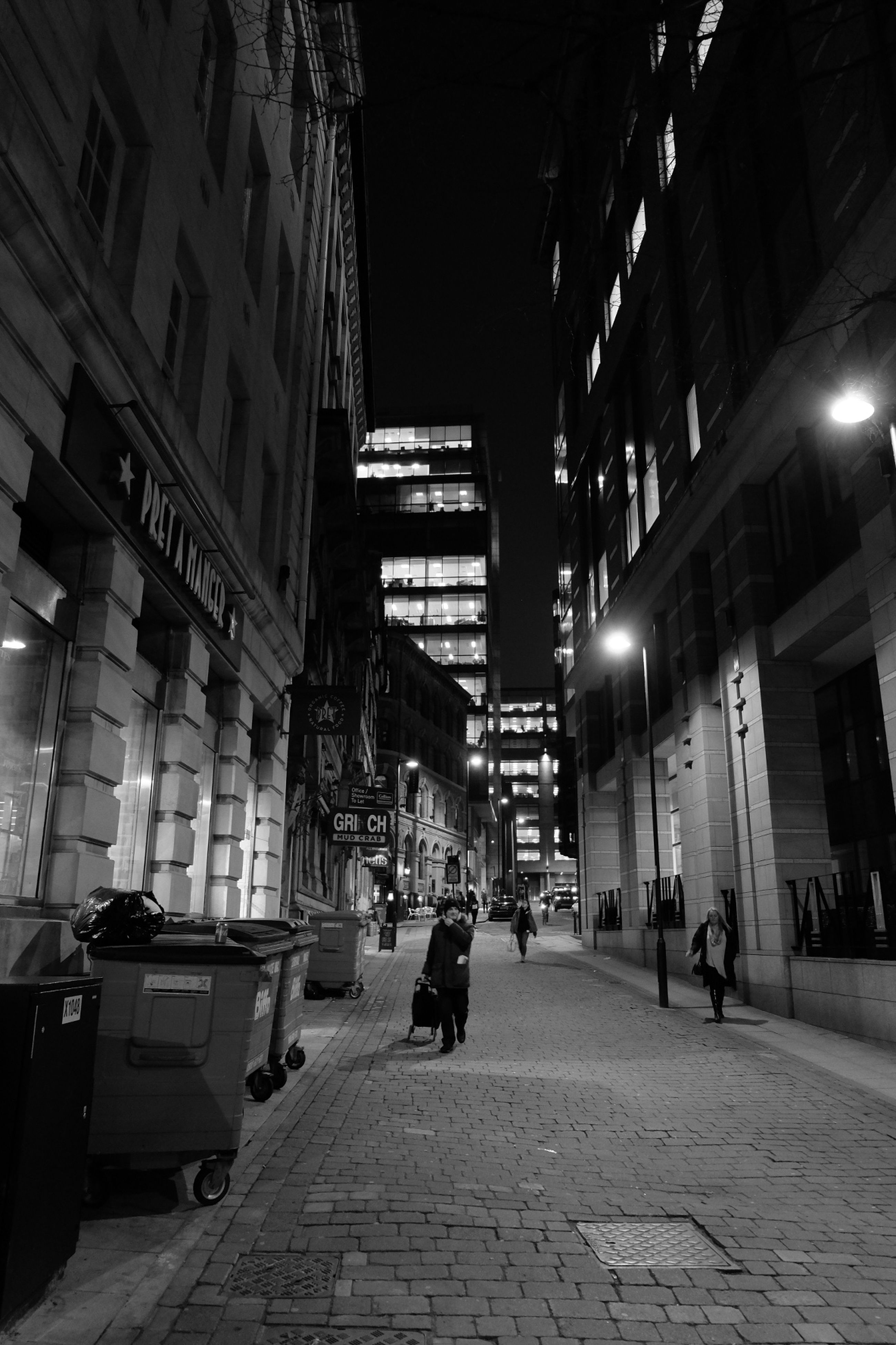 built structure, street, architecture, building exterior, city, night, illuminated, real people, walking, outdoors, men, one person, people, sky, adults only, adult, one man only