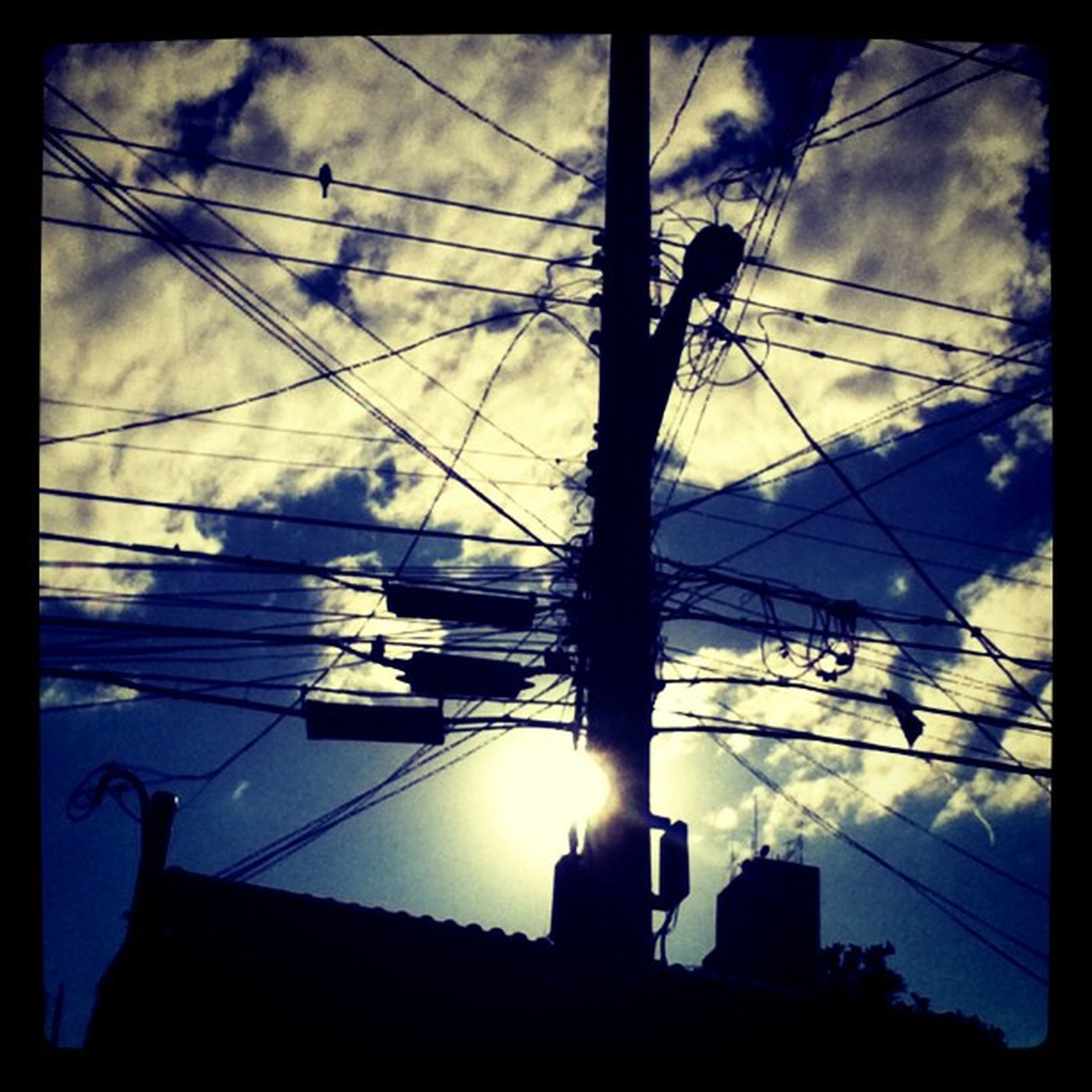 sky, low angle view, cloud - sky, silhouette, power line, electricity, power supply, cloudy, transfer print, cable, cloud, auto post production filter, electricity pylon, built structure, reflection, no people, technology, sunlight, fuel and power generation, architecture