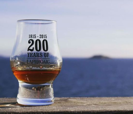 A whisky by the water . Drink Drinking Glass Alcohol Vacations No People Outdoors Nature Islaywhisky SingleMaltWhisky Scottish Scottishwhiskey Baltic Sea Bar Laphroaig Laphroig