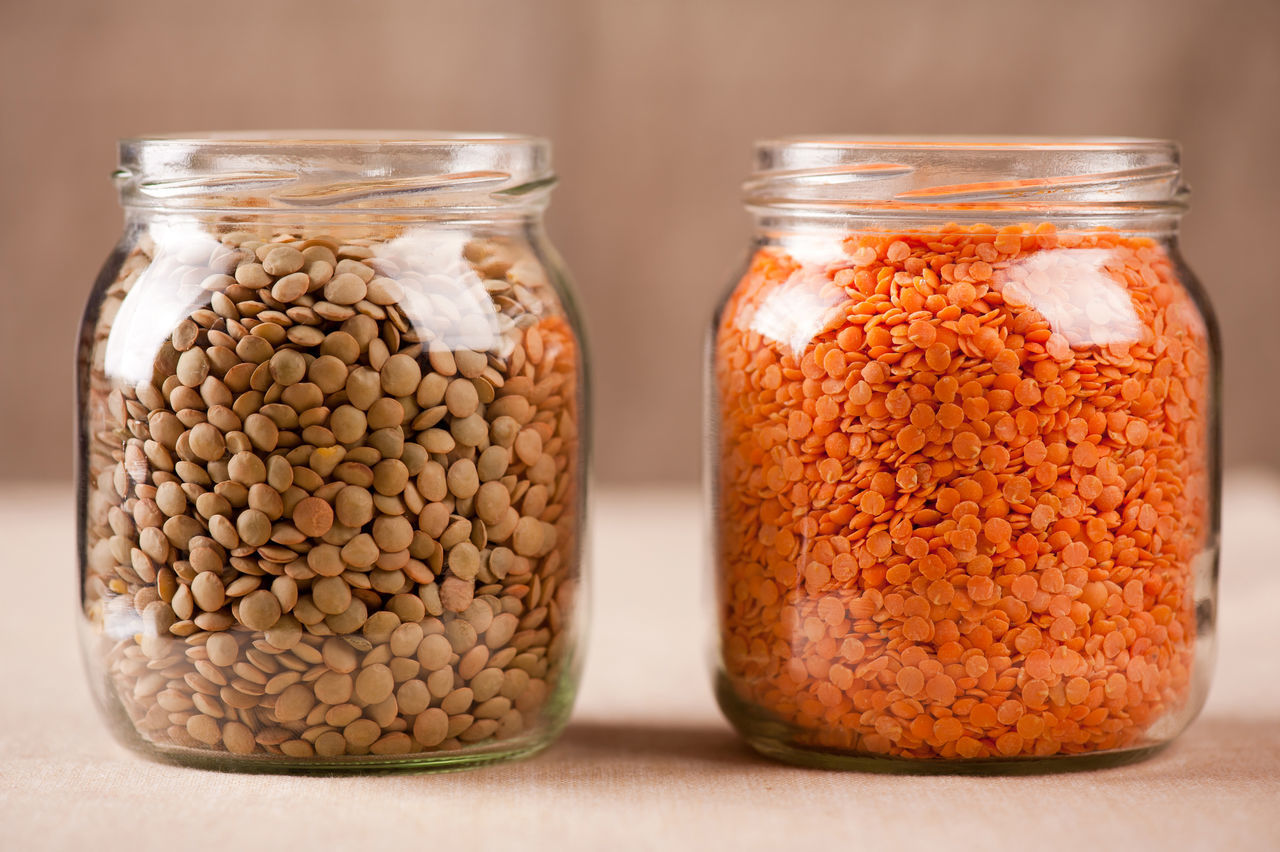 Red and green lentils seeds in glass jars, plenty healthy raw grains in studio shot, horizontal orientation, nobody. Culinary Dried Food Glass Jar Grain Grains Green Healthy Eating Jar Jars  Lens Culinaris Lentil Lentils No People Raw Red Seed Seeds Uncooked Vegetarian Food