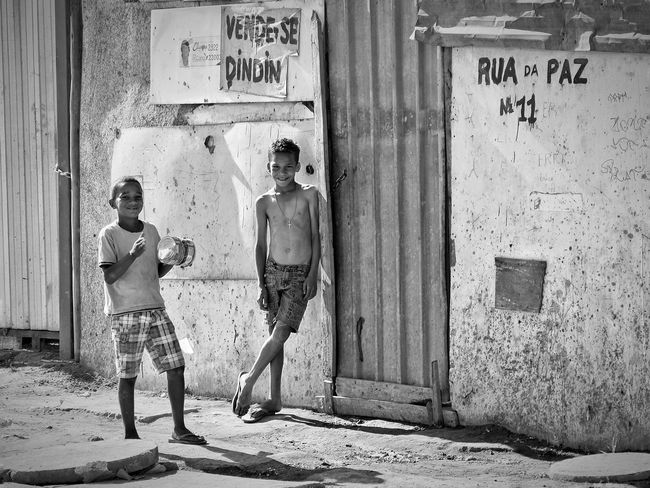 Togetherness Outdoors Childhood Boy Favela Street Streetphotography Street Photography Standing Casual Clothing Summer Daily Life Playing Brazilian Brasília Brasil Canon CarlZeiss Monochrome Photography