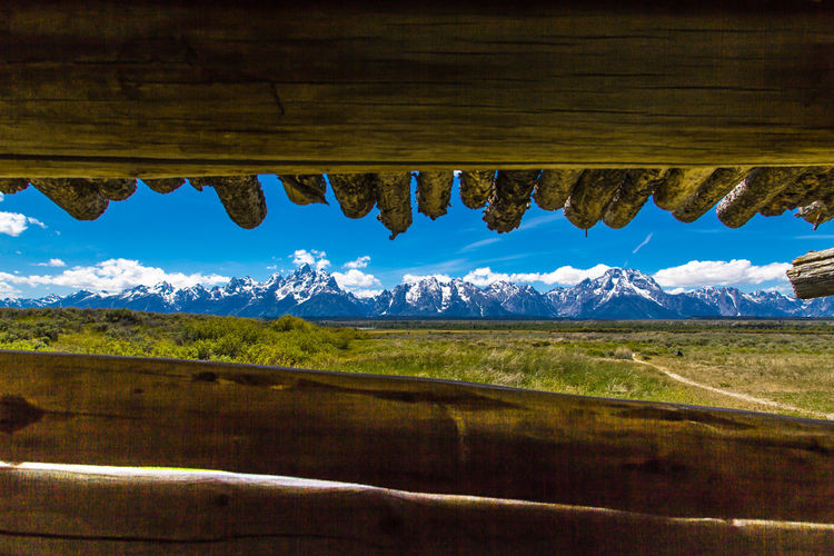 The view from the Cunningham Cabin, Jackson Hole, Wy Agriculture Beauty In Nature Blue Cunningham Cabin Day Grand Tetons National Park Landscape Mountain Mountains Nature No People Outdoors Rural Scene Scenics Sky Tree Water