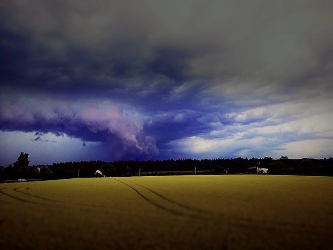 Photo Of Train Storm Clouds Summer Weather Energy Drink Field Liberec Millet Wrath Of God?