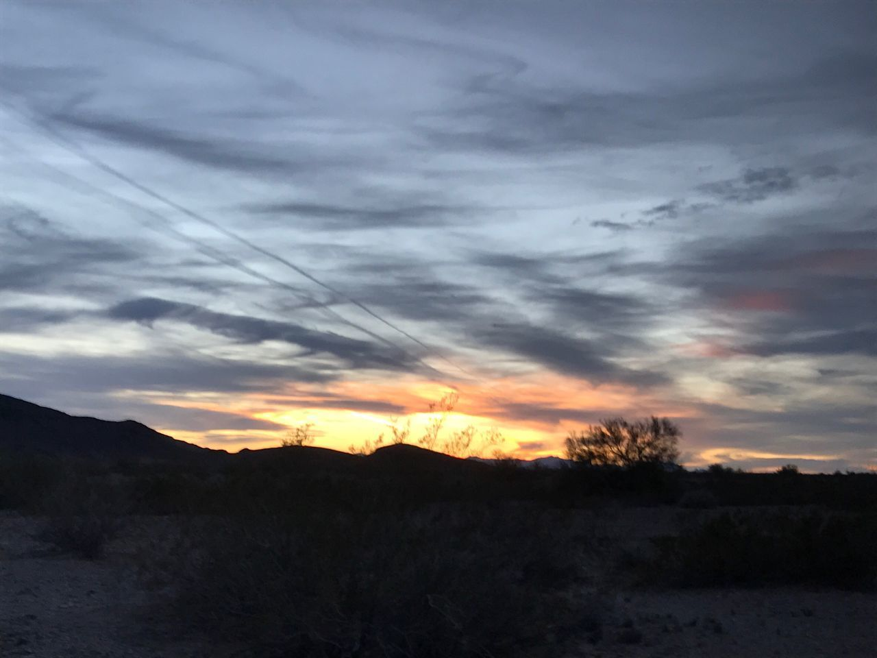 Sunset Nature Tranquility Beauty In Nature Sky Scenics Silhouette Tranquil Scene Cloud - Sky Landscape No People Outdoors Tree Mountain Day No Edit/no Filter Silhouette Arid Climate Desert Beauty