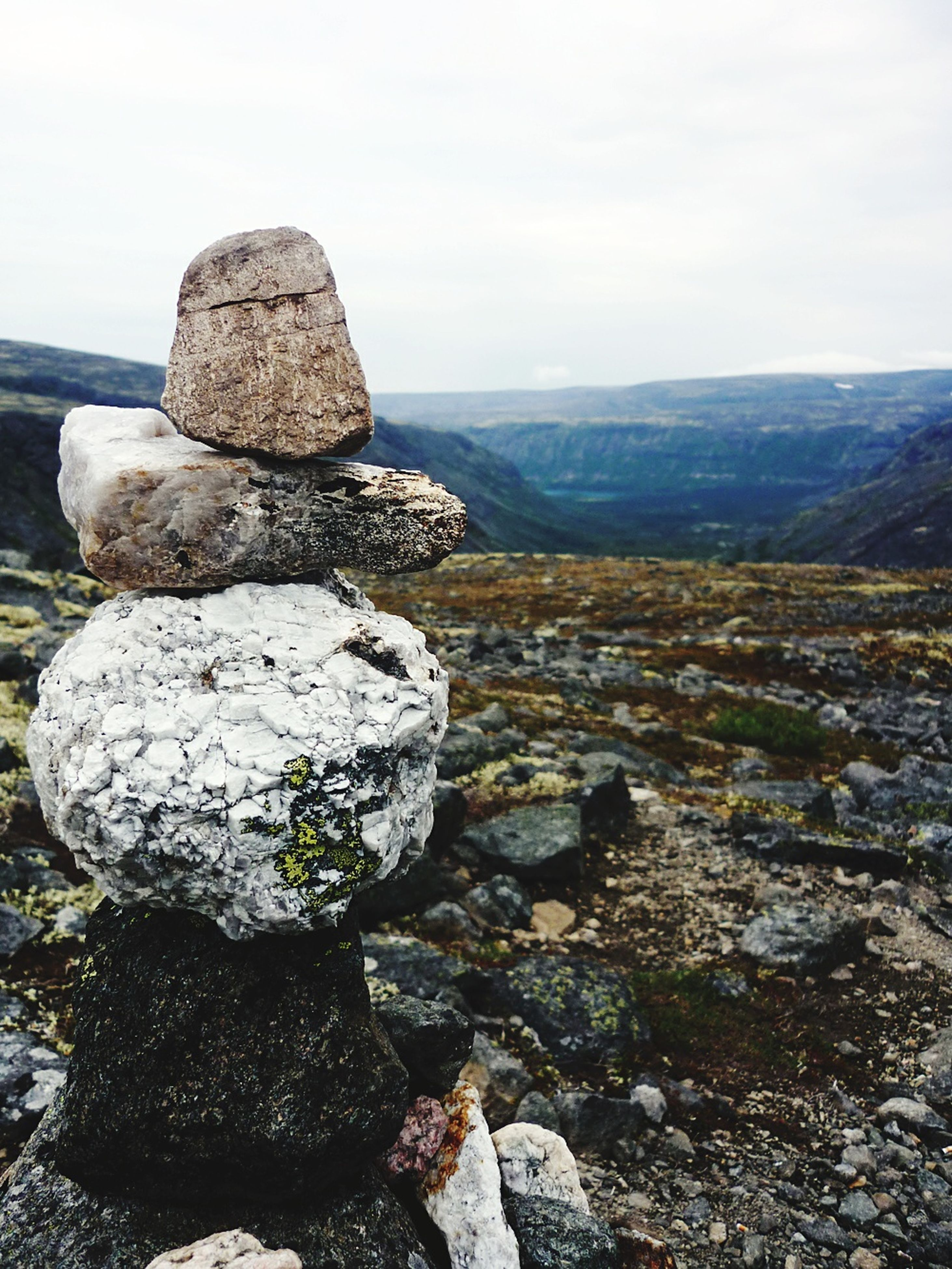 rock - object, tranquility, tranquil scene, scenics, rock formation, sky, rock, beauty in nature, nature, stack, stone - object, landscape, stone, water, mountain, sea, geology, non-urban scene, idyllic, remote