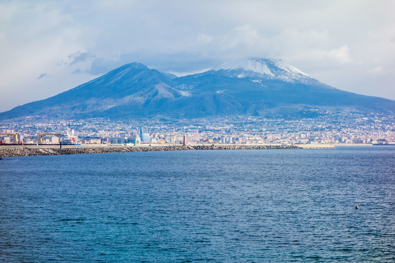 Naples view with vesuvio and sea. Architecture Bay Of Naples, Italy. Beauty In Nature City Cityscape Cloud - Sky Day Landscape Landscape #Nature #photography Mediterranean  Mountain Mountain Range Naples, Italy Nature No People Outdoors Sea Sky Snow Vesuvio Volcano Water