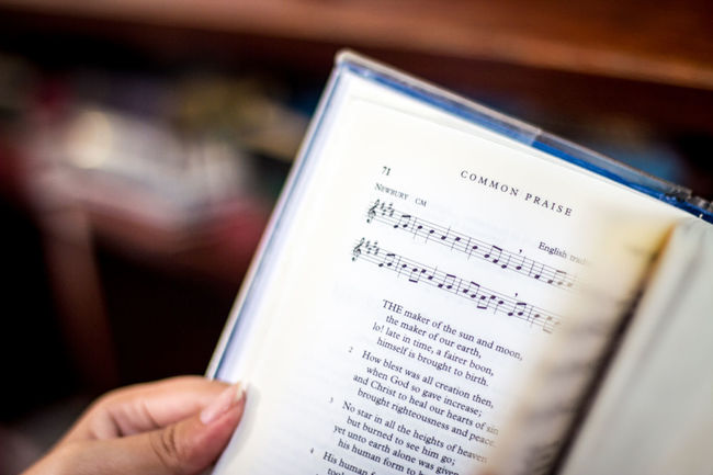 Hymn book in Church Book Church Close-up Cropped Education Focus On Foreground Holding Human Finger Hymns Lifestyles Page Paper Part Of Person Personal Perspective Praise And Worship Selective Focus Text Unrecognizable Person Writing