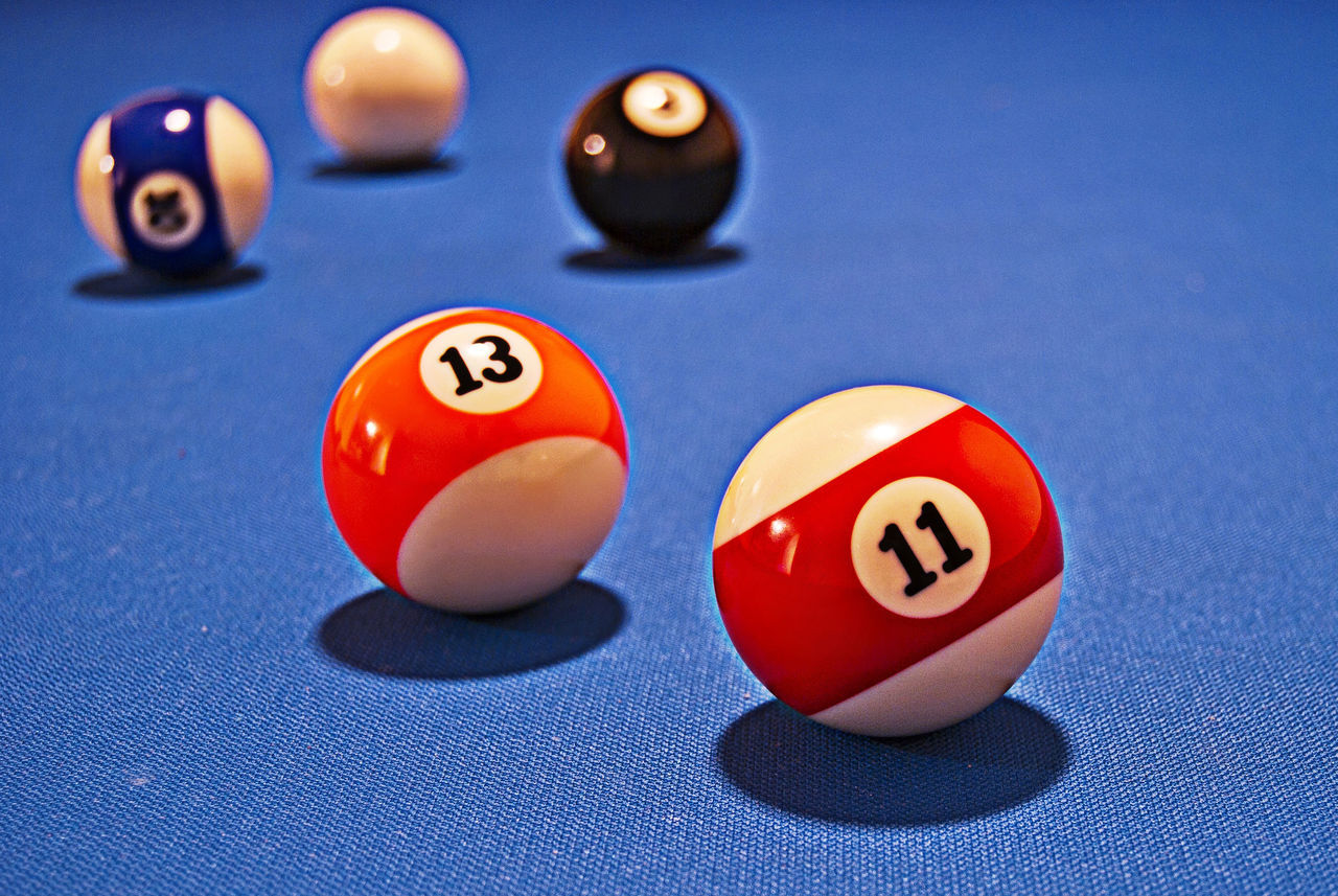 Pool balls on a blue pool table in the middle of a game. Ball Balls Black Blue Bright Close-up Cue Ball Depth Of Field Dof Eleven Focus On Foreground Leisure Games Multicolor Multicolors  No People Pool - Cue Sport Pool Ball Pool Cue Pool Table Red Shine Shining Sport Thirteen White