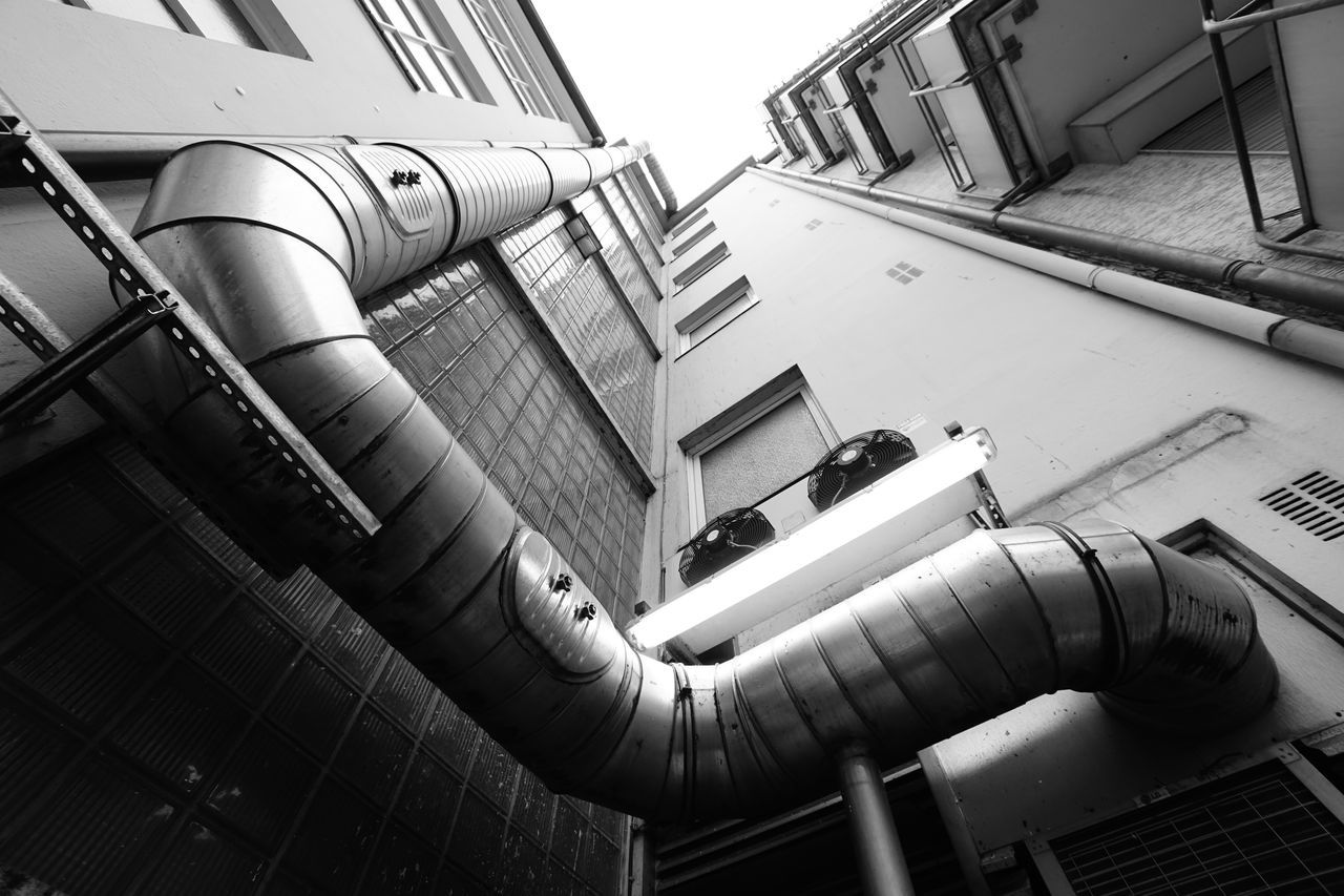 Urban Architecture Apartment Buildings Architecture Backyard Blackandwhite Building Exterior Building Exteriors Built Structure City City Climate Control Day Façade Lack And White Low Angle View Melancholy Metal Metal Pipes Moody No People Outdoors Perspective Pipes Pipework Urban Vanishing Point
