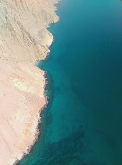 Nature Water Outdoors No People Intheair Turquoise Sea Beauty In Nature Blue Sea Air Perspective Oman Travelphotography Oman_photo Oman_traveller Oman_photography Nature Perspective View Coastline Coastline Landscape Perspective Photography Seaside Perspective Shot InTheSky View Microlight